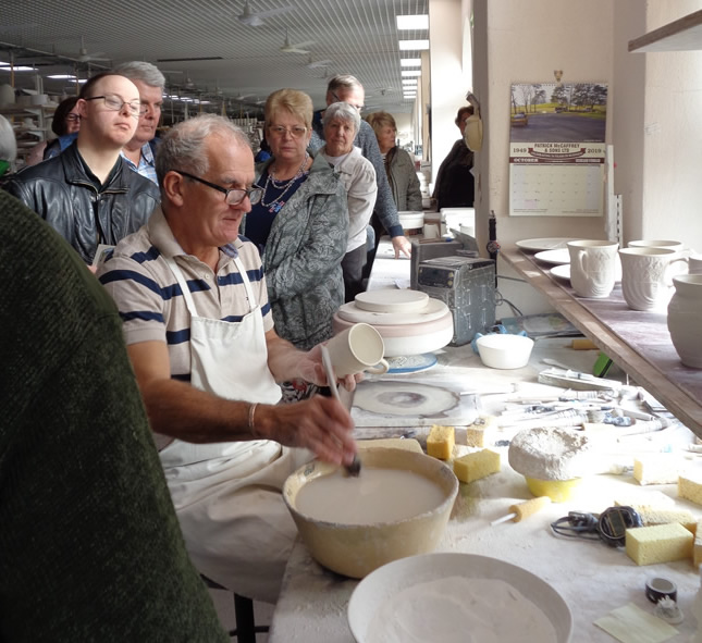 Brendan McCauley fettling a Belleek piece for gathering attendeees