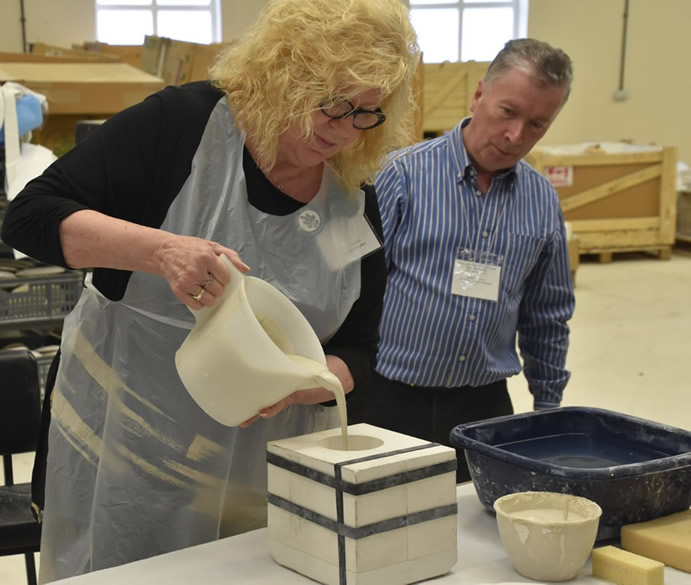 Johannah Purdon pouring slip into first mould